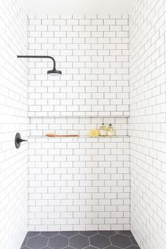 oil rubbed bronze shower head is fixed to white. - An oil rubbed bronze shower head is fixed to white. -An oil rubbed bronze shower head is fixed to white. - An oil rubbed bronze shower head is fixed to white. Tile Shower Niche, White Subway Tile Bathroom, Subway Tile Showers, Shower Floor Tile, Bathroom Showers, Tiled Showers, Bathroom Grey, Bathroom Closet, Bathroom Storage