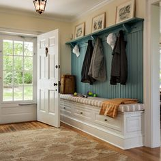 Nice mud room - might eliminate carpet though  traditional entry by Crisp Architects