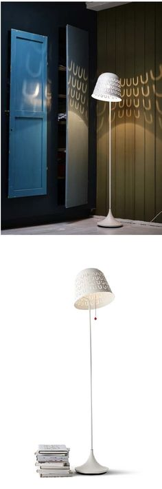 """IKEA PS 2014 floor lamp. """"My inspiration for the floor lamp was the idea of the dining table as the modern day campfire, where we gather and share information. That's where the shade you can attach notes to comes from. It also creates a beautiful pattern of light and the shade can be angled to direct the light."""" Designer Jon Karlsson."""