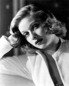 Lucille Ball, late thirties? Eyebrows thin, hair still short (30s) but lips 40s style: outlined to make full