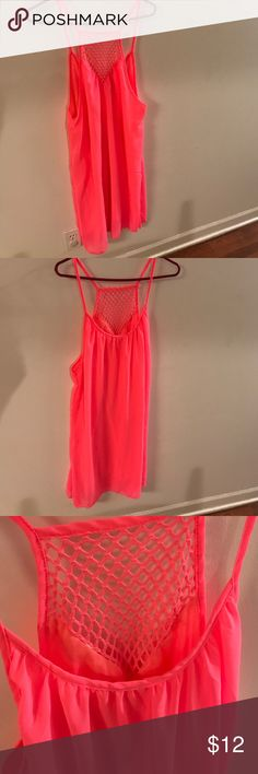 NWOT size S dress/cover up high-low NWOT never been worn neon pink dress/swim suit cover up size small. This would be more flowy on a person who wears an XS. Chiffon material extremely lightly lined. From top of shoulder to hem 38 inches long in front and 42 inches long in back. Measures 21 inch laying flat from arm pit to arm pit Dresses High Low