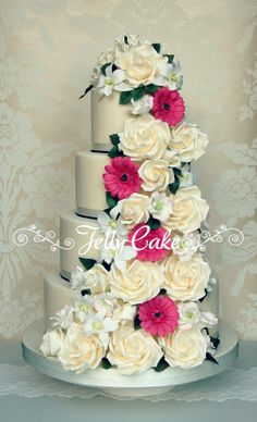 Floral Cascade Wedding Cake - A 4 tier cake decorated with a cascade of sugar roses, Singapore orchids, lisianthus and germini's to match the brides bouquet.