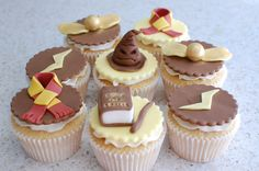 Harry Potter themed cupcakes.    For my daughter's class bake sale.  Her class is named 'Rowling' so it was an obvious choice of themed topper.