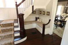 Under the stair bench seat, entry nook, custom bench cushion, historic home details