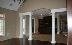 walls sw 6094 sensational sand. Ceilings and columns sw7005 Pure White.