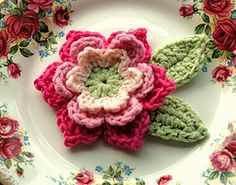 pink and green crochet flower