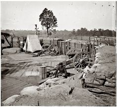 A Union soldier sits in a fort abandoned by the Confederates after the fall of Atlanta. Sept, 1864.