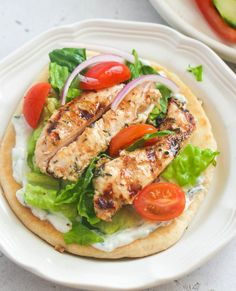 Chicken Gyros - Immaculate Bites #withtzatzikisauce #recipes #greek #easyrecipes #wrap #chickenrecipes #dinnerideas Baked Chicken Tenders, Chicken Gyros, Yummy Chicken Recipes, Yum Yum Chicken, Yogurt Marinated Chicken, Flatbread Recipes, Greek Chicken, Greek Salad, Light Recipes