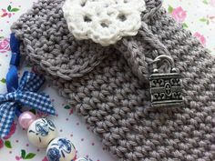 Crochet mobil phone sleeve decorated with charms and beads, original and one of a kind