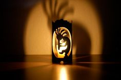 Kokopelli - Decorative Metal Candle Holder. $19.95, via Etsy.  the kokopelli cut out on the front and the back are lined up so the image on the front is shadowed on the wall
