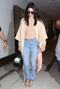 Kendall Jenner wearing Givenchy Lucrezia Bag, Givenchy Camel Suede Leather Pump, Saint Laurent Classic 11 Aviator Sunglasses, Fendi Pompom Bag Charm and Re/Done Elsa High Rise Jeans