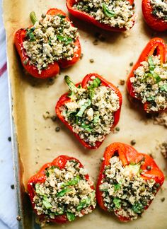 These healthy vegetarian stuffed peppers are full of lentils, couscous, basil and feta! They're simple to make and go great with a side salad. // @cookieandkate