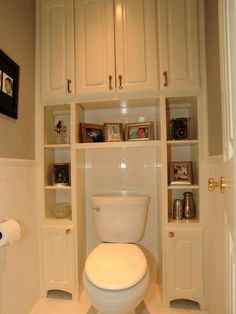 small space storage idea. so much wasted space by a toilet usually. love that this looks clean and organized but is very functional