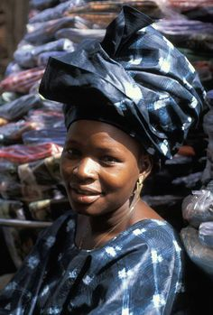 Africa | Textile seller in the village of Bamako, Mali | ©Michel Renaudeau