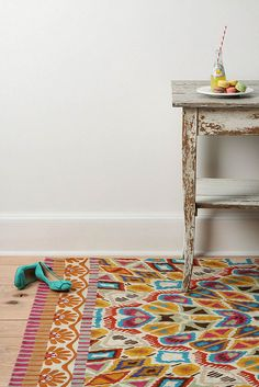 colorful rug to compliment neutral colors.  rugs by decor8, via Flickr