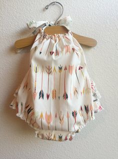 Ready to ship in 1-3 days! Little Arrows Ruffled Baby Girl Romper The romper is halter style, with extra long straps to make a fancy bow at the