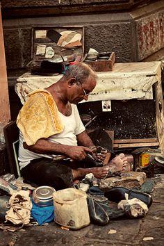 INDIA - Metal worker on the street in Mumbai