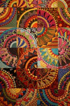 artist? The pattern in Cinco de Mayo, by Karen Stone, but can't find the quilter of this beauty.