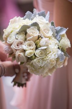 Pin for Later: 11 White Wedding Bouquets That Are Simply Perfect Quicksand Roses, Tibet Roses, Spray Roses, Hydrangea, Dusty Miller, and Blush Bride Protea