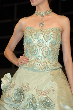 Strapless green wedding dress with beads and lace.