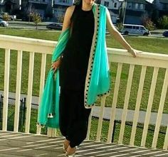 Full black dress with lovely attractive duptta of blueish green colour. Punjabi Dress, Pakistani Dresses, Indian Dresses, Designer Punjabi Suits, Indian Designer Outfits, Punjabi Fashion, Indian Fashion, Indian Suits, Indian Wear