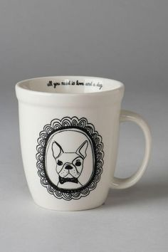"Dog lovers will absolutely flip over this precious mug! A framed portrait of a smug pup decorates the outside, while the inside reads: ""All you need is love and a dog.""<br /> <br /> - By Natural Life<br /> - Dishwasher and microwave safe<br /> - Imported<br />"