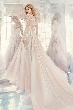 Amethyst long sleeve rococo bridal gown, beaded and embroidered bodice with illusion bateau neckline and V-neck front, full intricate back, tulle skirt with cathedral train. Hayley Paige Spring 2016 Wedding Dress Collection