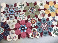 I have just added another row to this quilt, the more I make the more I like the look. I have also added some close up pictures. ...
