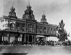 Pasadena Grand Opera House    1890.    This photograph depicts the Pasadena Grand Opera House in 1890, the year of its purchase by Professor Lowe. Offices for the Mt. Lowe Railway were established inside of the building. The horse-drawn coaches are festooned for a Rose Parade.