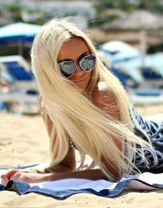Hair : With her long blonde hair blowing in the wind, Madison checks out all the good looking guys on the beach ....
