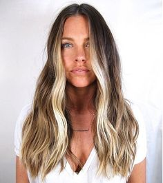 We're about to print and frame this work of art: the contrast of the blonde against her natural ashy tones complements her skin tone and makes her eyes pop. Image Source: Ramirez-Tran Salon