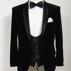 Timeless black velvet dinner suit teamed with a low cut scooped waistcoat. #classic #dinnersuit #dj #wedding #weddingsuit #essex #eveningsuit #tuxedo #tux #bowtie #waistcoat #madetomeasure #suit #sartorial #style #bond
