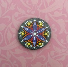 """Mandala Stone (Junior): Hand painted with acrylic and protected with a matt finish, this """"junior"""" stone is a touch smaller than my usual stones, at about 2.5 inches diameter. It is one-of-a-kind."""