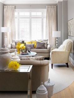 Assuming there's a fireplace on the left side of this living room, I like the layout. The light color scheme makes it seem like a bigger space. Combining plantation shutters with curtains. *shutters with curtains Living Room Decor, Home, Interior, Shutters With Curtains, Grey And Yellow Living Room, Living Room Grey, Contemporary Living Room, Contemporary Family Rooms, Yellow Living Room