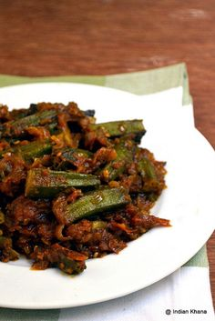 Punjabi Bhindi Okra/Bhindi - 400 gms Onion/Pyaz - 2 Large (Or 2 cups chopped) Tomato/Tamatar - 2 Large (or cups chopped) Green Chilli/- 3 Cilantro/- 2 tbsp Oil/- 2 tbsp Cumin Seeds/- 1 tsp tbsp Ginger-Garlic Paste] Red Veg Recipes, Indian Food Recipes, Vegetarian Recipes, Cooking Recipes, Recipies, Indian Foods, Punjabi Recipes, Indian Meal, Vegetarian Barbecue