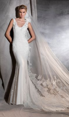 Try this sculptural crepe and tulle mermaid wedding dress, fitted to the hips with a v neck. An elegant style decorated with lace motifs. The detail: a delicate flower on one of the straps. Lace wedding dress from Pronovias. Available at Schaffer's in Des Moines, Iowa. Wedding Dress Info: PRONOVIAS – STYLE ORIANA.