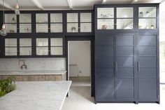 Blakes London, Industrial Chic Kitchen Contrasting black butler's pantry/storage with subway tiled interiors.