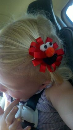 Elmo Hair Bow - DIY  Bella LOVES Elmo and I would love to make her ones of these, sadly the link doesn't bring up how to...