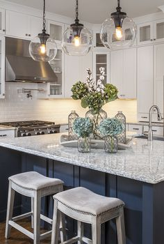 Gorgeous kitchen design by Lauren Nicole Designs featuring Tabby pendant lights by Feiss