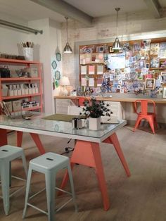 A designer's office. Paint is used to tie together seating and storage. Trinkets and print inspiration are displayed on a large mood board, and books are treated like decor, arranged in multiple...
