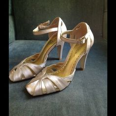 BCBG Edina Champagne Satin Heels NWOT Never worn, these BCBG heels with ankle strap,3.5inch heels feature exquisite cut out detail at toe area. Matte gold leather trims all seams, open work. Beautiful gold leather lined. Leather sole, pristine condition. They have been stored protectively in original box and have never been to the party, any party. Price firm. BCBG Shoes Heels