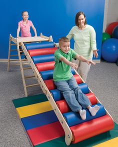 The Steamroller Ramp offers sensory stimulation, heavy work, bilateral coordination and motor planning. View more information at Southpaw today! Sensory Rooms, Autism Sensory, Sensory Activities, Sensory Play, Multi Sensory, Sensory Tubs, Pediatric Physical Therapy, Pediatric Ot, Occupational Therapy