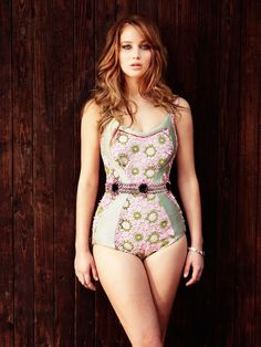 Actress Jennifer Lawrence. love the return of the one piece. So hot and shows off a woman's gorgeous curves!! <3