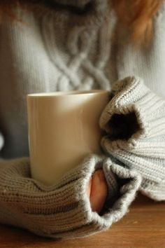 This could be me at the end of fall.....warming up with a comfy sweater and a hot cup of tea