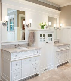 Large traditional l-shaped open concept kitchen in Minneapolis with an undermount sink, flat-panel cabinets, white cabinets, granite countertops, white backsplash, ceramic backsplash, paneled appliances, light hardwood floors and an island.Inspiration for