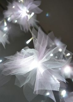 """tulle tied on string lights """"fairy tale"""" feel for the head table"""