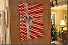 Wrap pretty gift wrap around art work already hanging in your home.....then hang it back up!!  http://jamiebrock.hubpages.com/hub/Home-Decorating-on-a-Budget-Christmas-Decoration-Ideas
