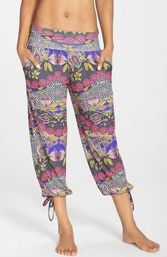 Free shipping and returns on ONZIE 'Gypsy' Pants at Nordstrom.com. Easy-fitting pants crafted from fast-drying and breathable Free-Flow fabric are styled with a fold-over waistband and drawstring ties at the capri-length cuffs.