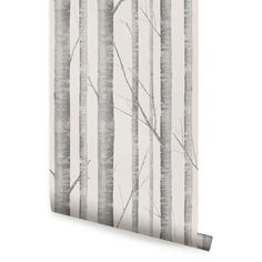 Birch tree warm grey peel & stick fabric wallpaper. This re-positionable wallpaper is designed and made in our studios in New Jersey. The designs are