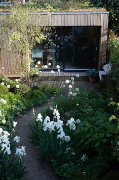 Visit: Sheila Jack's White Garden in West London A work studio faces the house in Sheila Jack's garden in Hammersmith, London.A work studio faces the house in Sheila Jack's garden in Hammersmith, London.